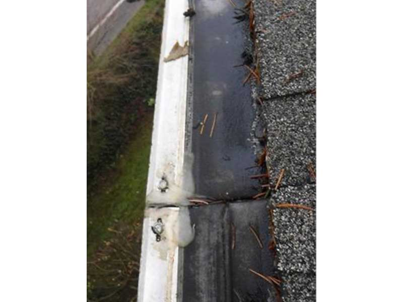 Once the debris is cleaned off the algae underneath is apparent, there is no wonder as to why the water was cascading over the top of the system instead of going into the gutter.