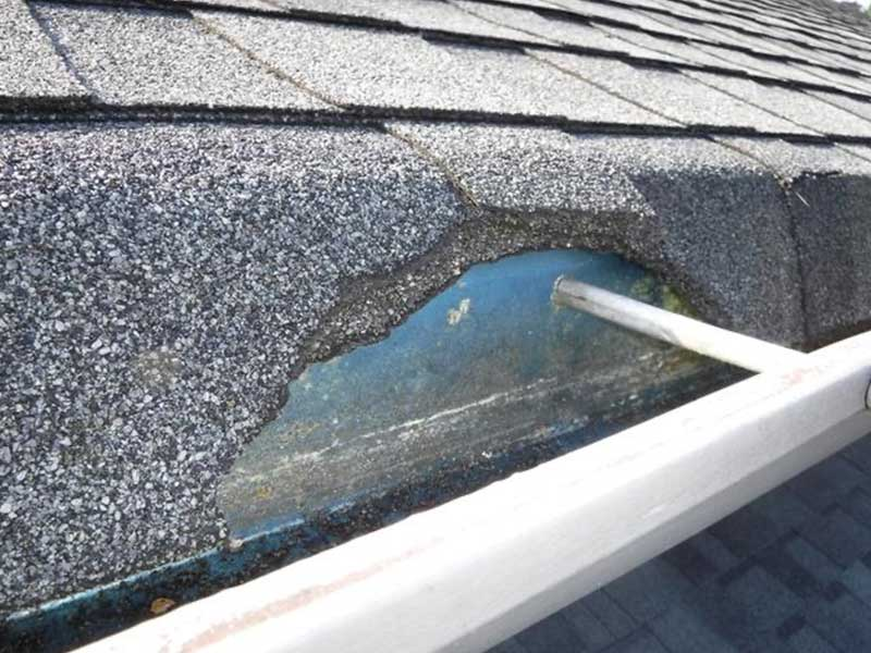 Roof has fallen into stake style gutters.