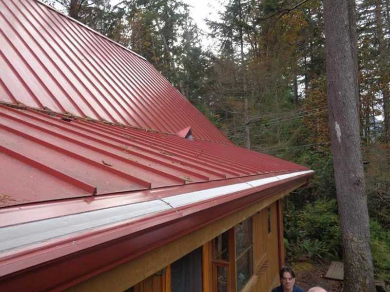 Cleared roof with new gutters and MasterShield gutter protection installed in Monroe, WA