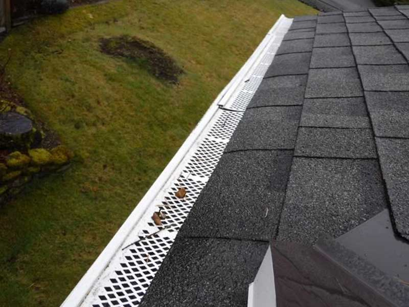 DIY gutter protection that was installed and caused damage to the fascia and existing gutters