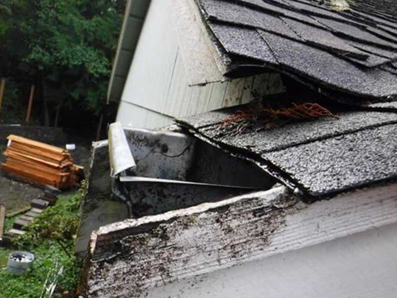 You can see here how high the gutter was installed relative to the roof, any clogging and water is going back up!