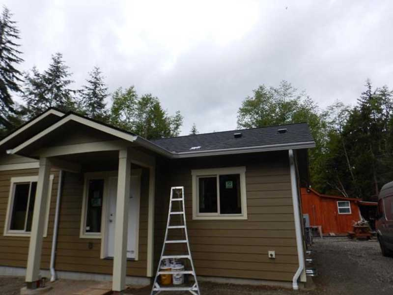 Installing the new gutter system in Port Townsend, Washington