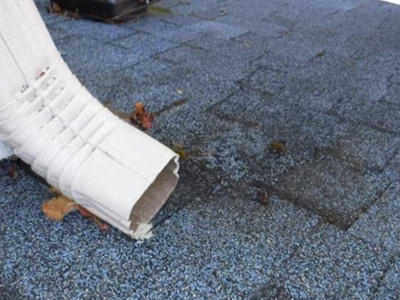 Roof erosion due to errand downspout.