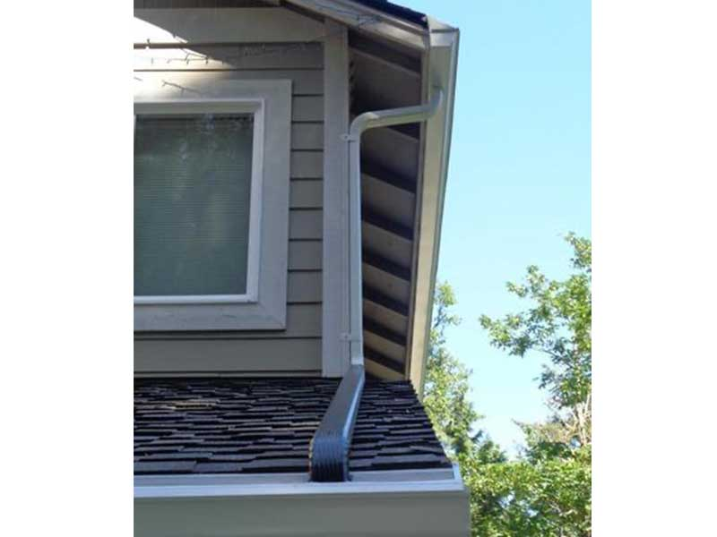 Tin-in downspouts help to manage the water flow from story to story
