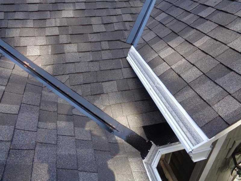 A valley controller is installed to help to disperse the water and drain properly into the gutter.