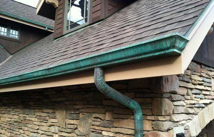 Copper gutters with patina